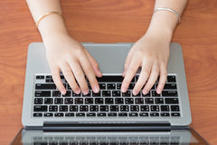 Hand on computer keyboard for business concept background. Royalty Free Stock Image