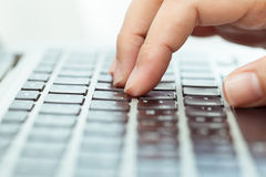 Hand on computer keyboard for business concept background. Stock Image