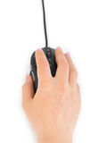Hand and computer mouse Stock Photography