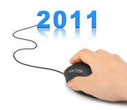 Hand with computer mouse and 2011 Royalty Free Stock Photography