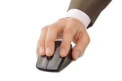Hand with computer mouse. Hand scrolling a wireless computer mouse on white background Stock Images