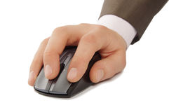 Hand with computer mouse. Hand scrolling a wireless computer mouse on white background Stock Photography