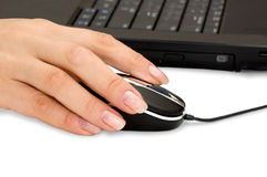 Hand & computer mouse Stock Images