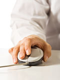 Hand with computer mouse Royalty Free Stock Image