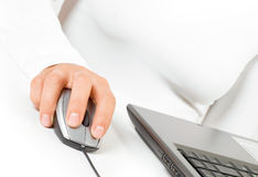 Hand on computer mouse Stock Photos