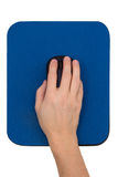 Hand on a computer mouse on a blue mouse pad Stock Photography