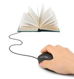 Hand with computer mouse and book. Technology concept royalty free stock photos