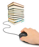 Hand with computer mouse and books Royalty Free Stock Photography