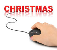 Hand with computer mouse and Christmas Stock Images
