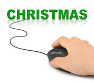 Hand with computer mouse and Christmas Stock Photo