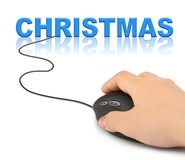 Hand with computer mouse and Christmas stock image