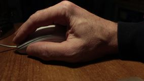 Hand and computer mouse stock video footage