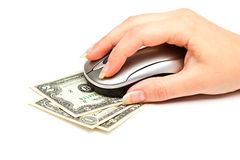 Hand with computer mouse on dollars bill Royalty Free Stock Photos