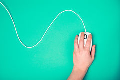 Hand on computer mouse Stock Photo