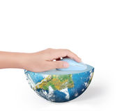 Hand with computer mouse and globe Royalty Free Stock Photography