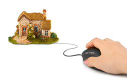 Hand with computer mouse and house Royalty Free Stock Image