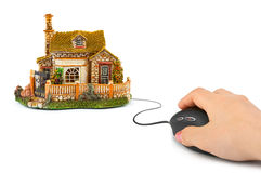 Hand with computer mouse and house Royalty Free Stock Photos