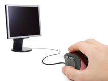 Hand with computer mouse and monitor Royalty Free Stock Photography