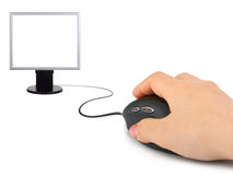 Hand with computer mouse and monitor Royalty Free Stock Images