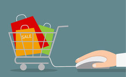 Hand with computer mouse and shopping cart with sale. Royalty Free Stock Photos