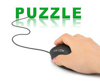 Hand with computer mouse and word Puzzle Royalty Free Stock Image