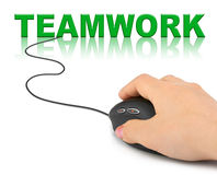 Hand with computer mouse and word Teamwork Royalty Free Stock Images