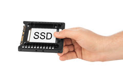 Hand and computer SSD drive Royalty Free Stock Photo
