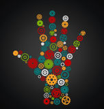 Hand consisting of gears multi color on a black background.  Royalty Free Stock Photo