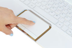 Hand control on laptop touchpad Stock Images