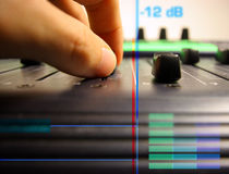Hand controlling faders Royalty Free Stock Photography