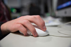 Hand Controlling Mouse Royalty Free Stock Image