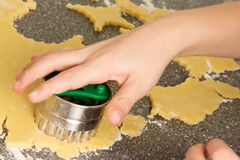 Hand with cookie cutter Royalty Free Stock Image