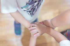 The hand coordination of childrens to show their unity. The hand coordination of childrens to show their unity and spirit royalty free stock photography