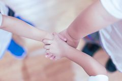The hand coordination of childrens to show their unity. The hand coordination of childrens to show their unity and spirit royalty free stock images
