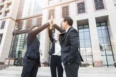 Hand coordination of team businessman on sky infront of bank bui. Lding, office after successful project stock photos