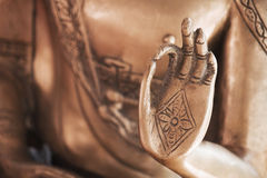 Hand of the copper Buddha 02. Hand of a copper Buddha sculpture royalty free stock photo