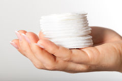 Hand with cotton pads Stock Photo