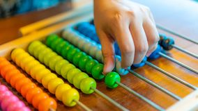Hand Counting On Colorful Abacus royalty free stock photo