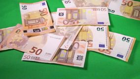 50 Euro money. Hand is counting 50 Euro money on the table stock video footage