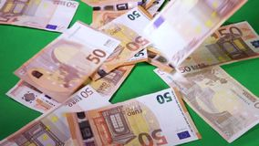50 Euro money. Hand is counting 50 Euro money on the table stock footage