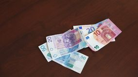 Polish zloty - zl money banknotes with euro banknotes exchange. Hand counting official currency of Poland in denominations of 10, 20 & 50 zloty bills with 10 stock video footage
