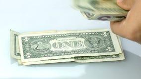 Hand counting us dollars bills closeup stock footage