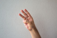A hand counting with a white background. A hand counting the numbers with a white background stock photography