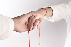 A hand of couple touch each other. The Faith of red thread brings destiny.  Royalty Free Stock Photos