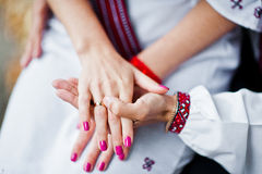 Hand of couple on traditional dress Royalty Free Stock Image