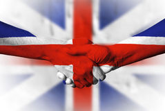 Hand covered in flag of United Kingdom Royalty Free Stock Photos