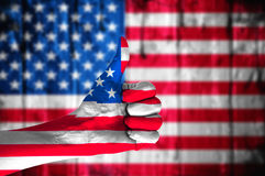 Hand covered in flag of USA. Royalty Free Stock Photos