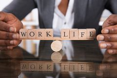 Free Hand Covering Balance Between Life And Work On Seesaw Royalty Free Stock Photos - 124745598