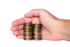 Hand covers the monetary savings coins Stock Photos