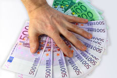 The hand covers paper money. Of Euro for a light background Stock Photo